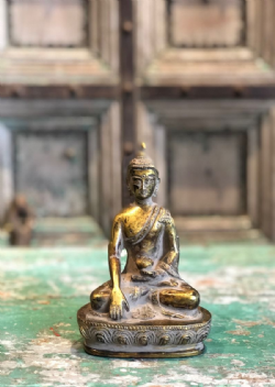 Bronze casting Buddha w/ golden detailing in bhumispasha hand mudra symbolising enlightenment